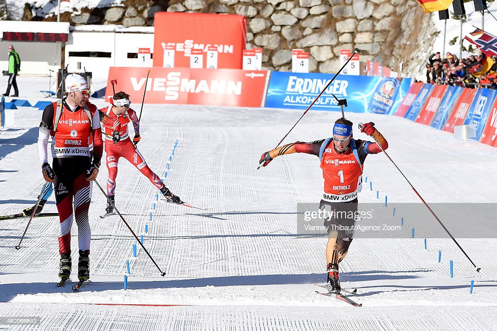 Simon Schempp (R) of Germany takes 1st place, Simon Eder of Austria takes 2nd place during the IBU Biathlon World Cup Men's and Women's Pursuit on January 24, 2015 in Antholz-Anterselva, Italy.