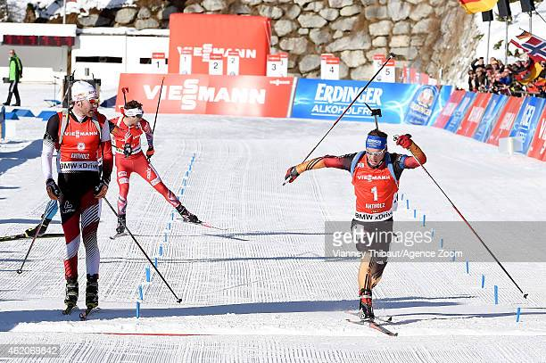 Simon Schempp of Germany takes 1st place, Simon Eder of Austria takes 2nd place during the IBU Biathlon World Cup Men's and Women's Pursuit on...