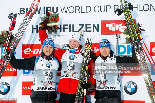 Simon Schempp of Germany takes 2nd place Johannes Thingnes Boe of Norway takes1st place,Andreas Birnbacher of Germany takes 3rd place during the IBU...