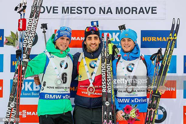 Simon Schempp of Germany takes 2nd place, Martin Fourcade of France takes 1st place, Anton Babikov of Russia takes 3rd place during the IBU Biathlon...