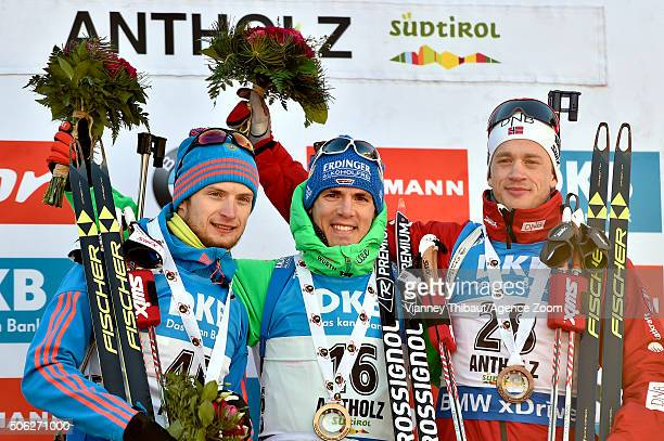Simon Schempp of Germany takes first place, Maxim Tsvetkov of Russia takes 2nd place, Tarjei Boe of Norway takes 3rd place during the IBU Biathlon...