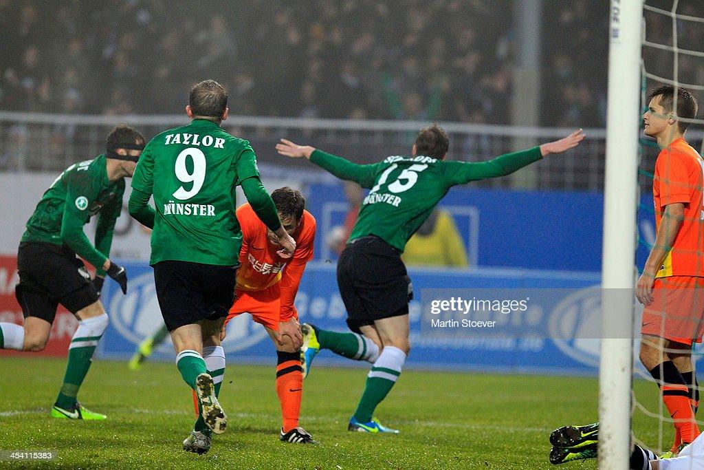 Simon Scherder of Muenster celebrates his goal during the Third League match between Preussen Muenster and MSV Duisburg at Preussenstadion on December 7, 2013 in Muenster, Germany.