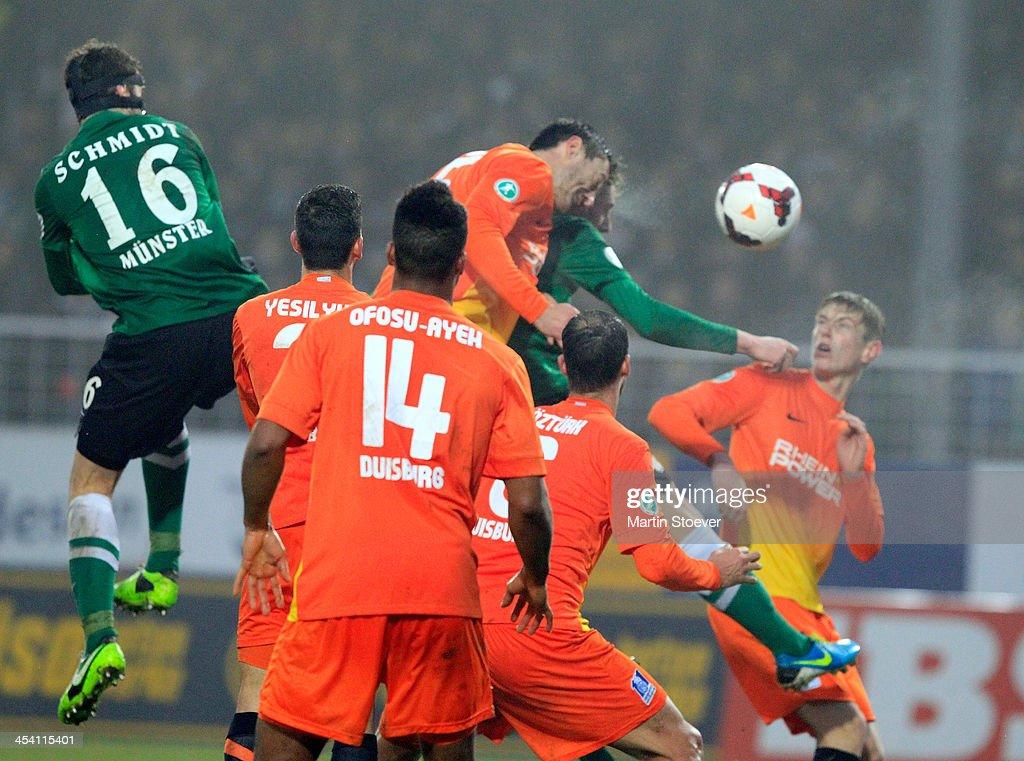 Simon Scherder of Muenster scores his goal during the Third League match between Preussen Muenster and MSV Duisburg at Preussenstadion on December 7, 2013 in Muenster, Germany.