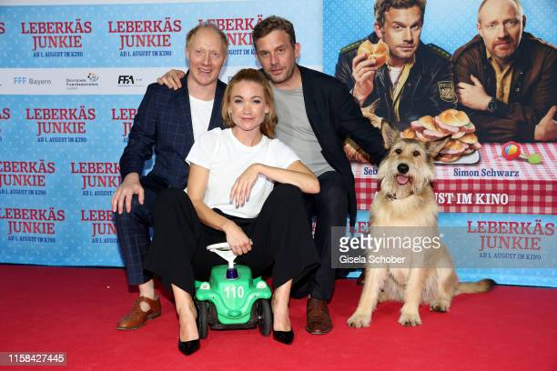 Simon Schwarz alias Rudi Birkenberger Lisa Maria Potthoff alias Susi and Sebastian Bezzel alias Franz Eberhofer and dog Ludwig during the premiere of...