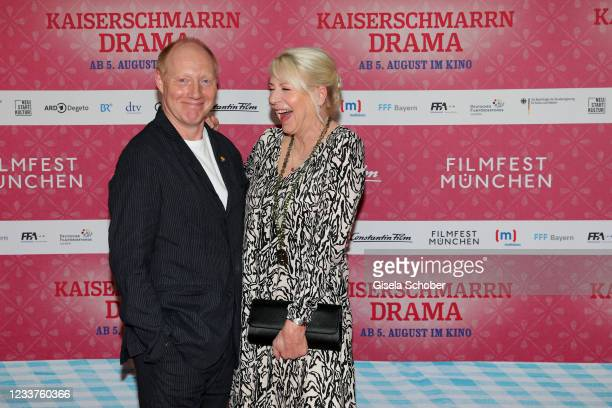 """Simon Schwarz and author Rita Falk attend the premiere of """"Kaiserschmarrndrama"""" during the opening of the 38th Munich Film Festival on July 1, 2021..."""