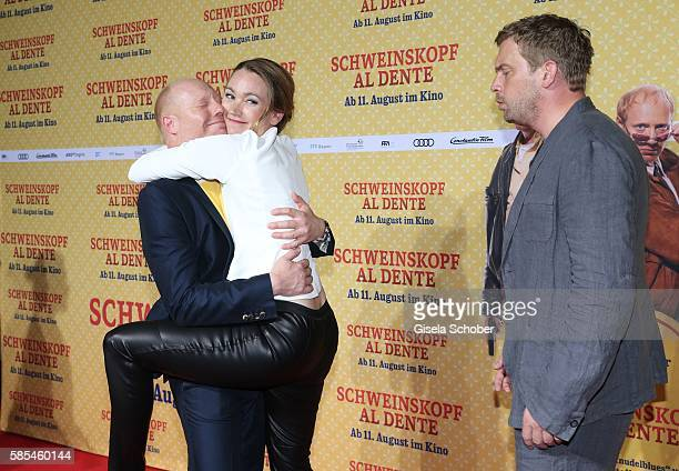 Simon Schwarz Lisa Maria Potthoff and Sebastian Bezzel during the premiere of the film 'Schweinskopf al dente' at Mathaeser Filmpalast on August 2...