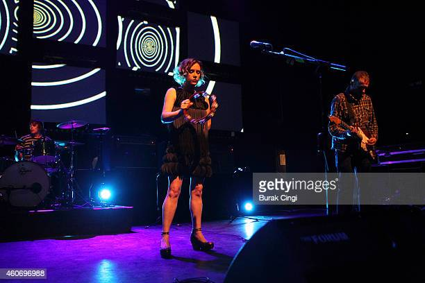 Simon Scott Rachel Goswell and Christian Savill of Slowdive perform on stage at The Forum on December 19 2014 in London United Kingdom