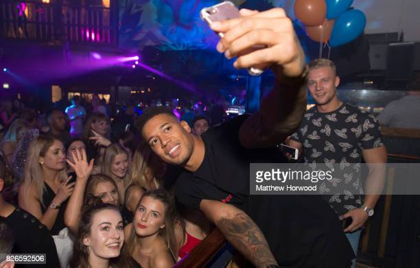 Simon Searles from the ITV reality TV series 'Love Island' takes a selfie with fans at Walkabout on August 4 2017 in Cardiff Wales