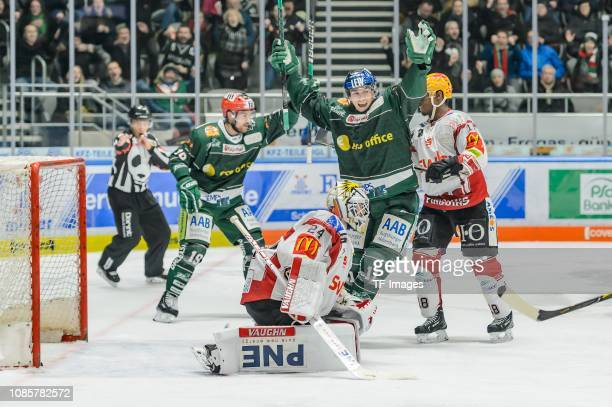 Simon Sezemsky of AEV Augsburger Panther celebrates after scoring his team's second goal with Adam Payerl of AEV Augsburger Panther during the DEL...
