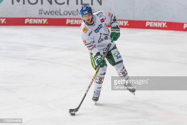 Simon Sezemsky of Augsburger Panther controls the puck during the DEL match between EHC Red Bull Muenchen and Augsburger Panther on January 12, 2021...