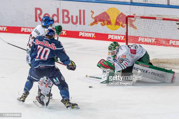 Simon Sezemsky of Augsburger Panther, Maximilian Daubner of EHC Red Bull Muenchen and goalkeeper Markus Keller of Augsburger Panther battle for the...