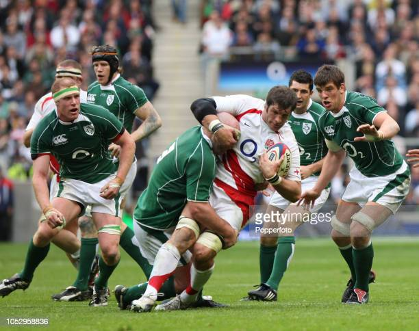 Simon Shaw of England is tackled by John Hayes of Ireland during the RBS 6 Nations Championship match between England and Ireland at Twickenham on...