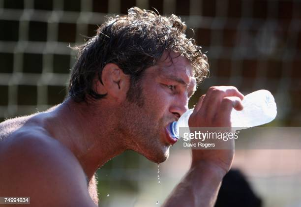 Simon Shaw of England takes a drink in the heat during the England training session held at Browns Sports Complex on July 3, 2007 in Vilamoura,...