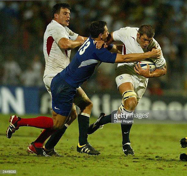 Simon Shaw the England replacement lock moves forward with the ball as Yannick Jauzion attempts to tackle during the Rugby Union International match...