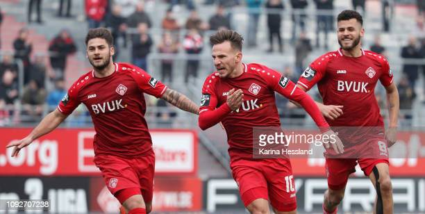Simon Skarlatidis of Wuerzburg celebrates the opening goal with teammates during the 3Liga match between Wuerzburger Kickers and VfR Aalen at...
