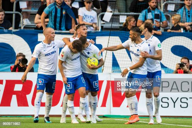 Simon Skrabb and IFK Norrkoping teammates celebrate scoring the 11 goal during an Allsvenskan match between Djurgardens IF and IFK Norrkoping at...