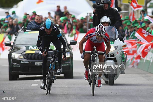Simon Spilak of Slovakia and Team Katusha claims victory from Chris Froome of Great Britain and Team Sky during stage three of the Tour de Romandie...