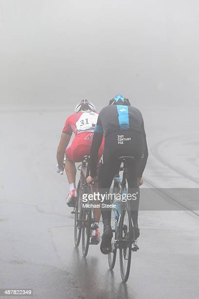 Simon Spilak of Slovakia and Team Katusha is closely followed by Chris Froome of Great Britain and Team Sky as both riders desend the fourth category...