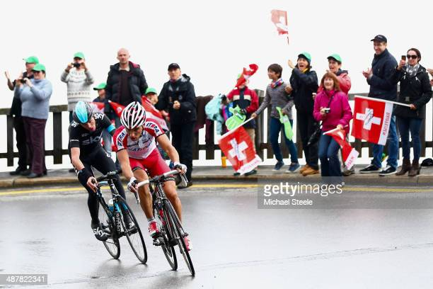 Simon Spilak of Slovakia and Team Katusha leads from Chris Froome of Great Britain and Team Sky on the fourth category one climb during stage three...