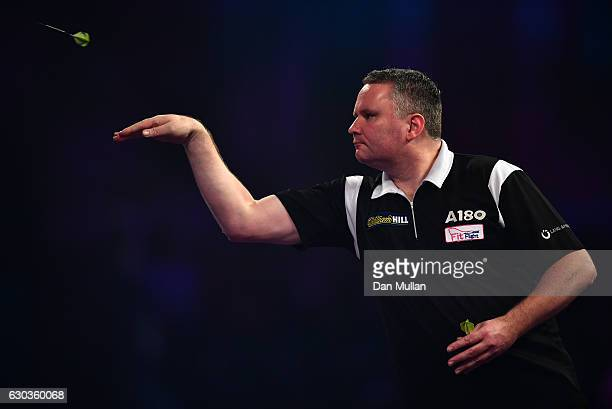 Simon Stevenson of England throws during his preliminary round match against Zoran Lerchbacher of Austria on day seven of the 2017 William Hill PDC...