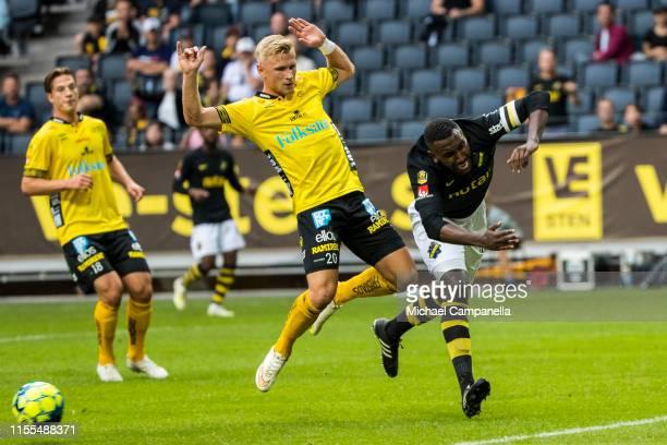 Simon Strand of IF Elfsborg fouls Henok Goitom of AIK during an Allsvenskan match between AIK and IF Elfsborg at Friends Arena on July 13, 2019 in...