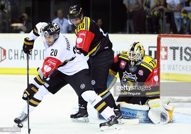 Simon Suoranta wants to bring the puck to the goal from Tomas Duba Andreas Driendl stands between themduring the Champions Hockey League group stage...