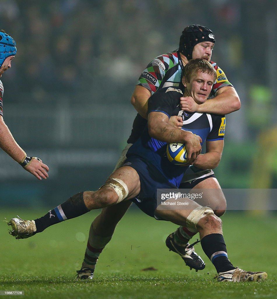 Simon Taylor of Bath is tackled by Mark Lambert of Harlequins during the Aviva Premiership match between Bath and Harlequins at the Recreation Ground on November 23, 2012 in Bath, England.