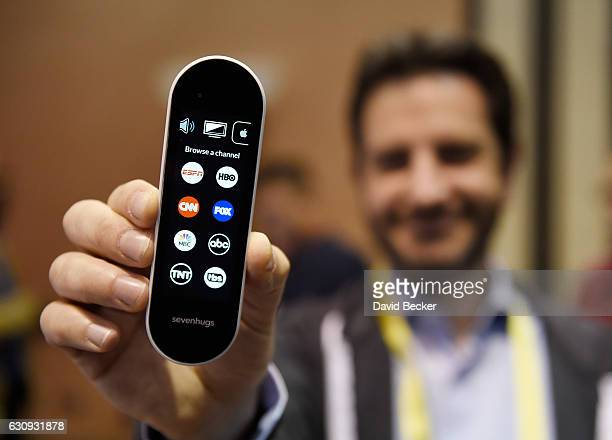 Simon Tchedikian displays a Sevenhugs smart remote during a press event for CES 2017 at the Mandalay Bay Convention Center on January 3 2017 in Las...