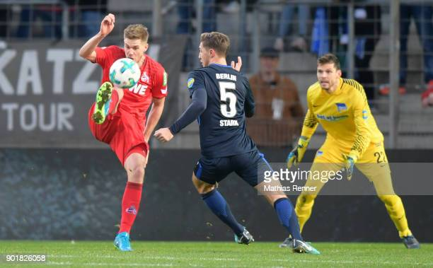 Simon Terodde of 1 FC Koeln Niklas Stark and Rune Almenning Jarstein of Hertha BSC during the test match between Hertha BSC and dem 1 FC Koeln on...