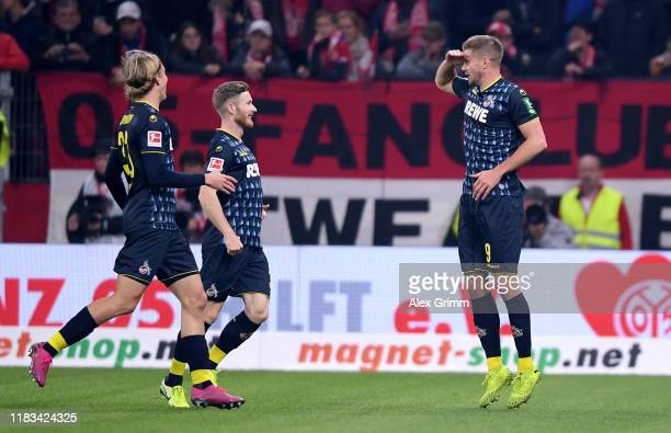 Simon Terodde of 1.FC Koln is congratulated after scoring the opening goal during the Bundesliga match between 1. FSV Mainz 05 and 1. FC Koeln at...