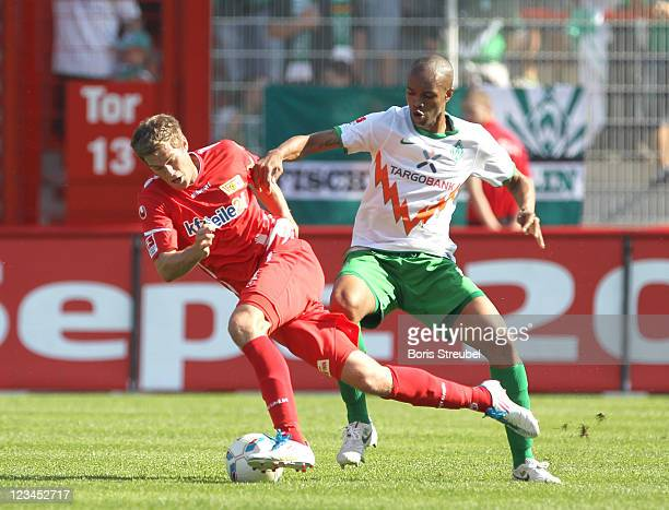 Simon Terodde of Berlin battles for the ball with Naldo of Bremen during the Season Friendly match between Union Berlin and Werder Bremen at Alte...
