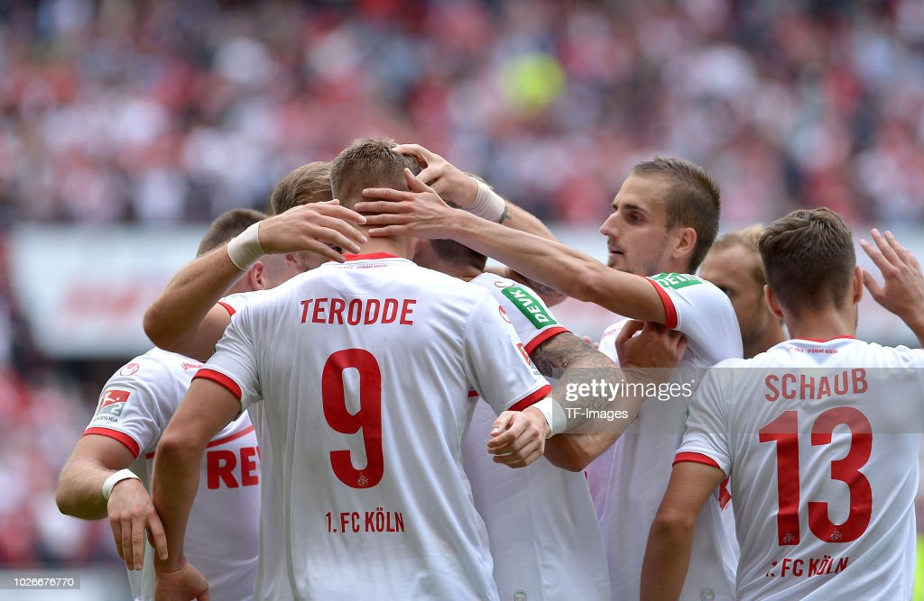 Simon Terodde of FC Koeln celebrates after scoring his team`s second goal during the second Bundesliga match between FC Koeln and FC Erzgebirge Aue at RheinEnergieStadion on August 25, 2018 in Cologne, Germany.