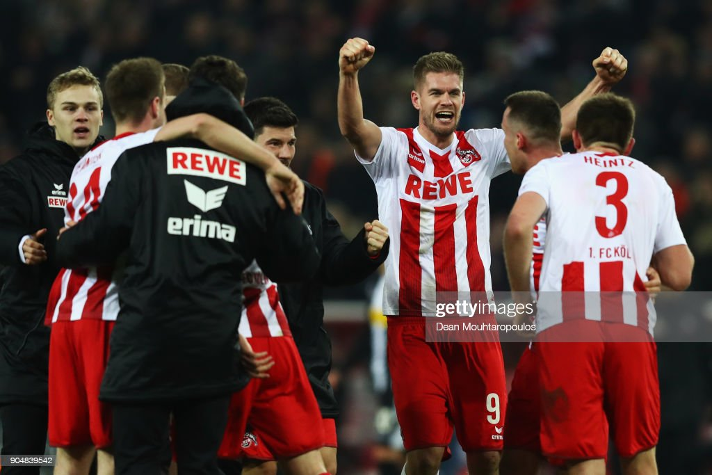 Simon Terodde #9 of FC Koeln, scorer of the winning goal celebrates with team mates after the game during the Bundesliga match between 1. FC Koeln and Borussia Moenchengladbach at RheinEnergieStadion on January 14, 2018 in Cologne, Germany.