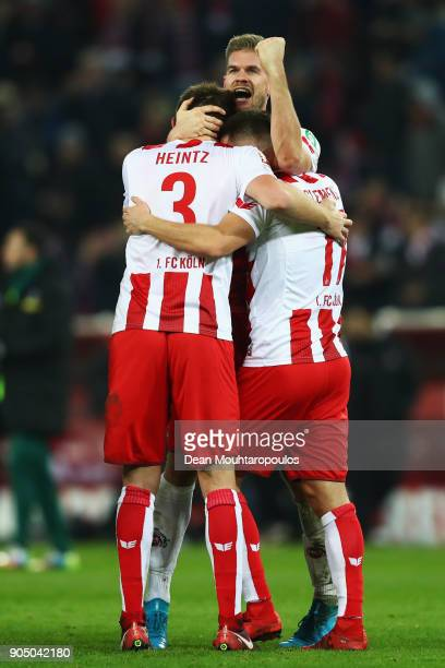 Simon Terodde of FC Koeln scorer of the winning goal celebrates with team mates after the game during the Bundesliga match between 1 FC Koeln and...