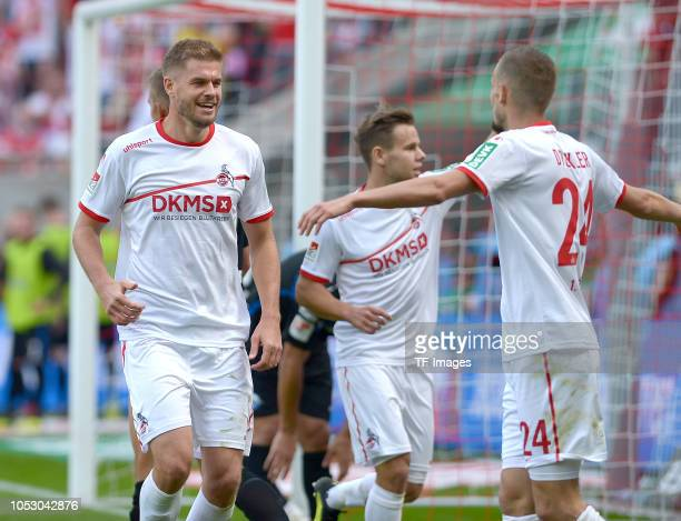 Simon Terodde of Koeln celebrates after scoring his team`s second goal with team mates during the Second Bundesliga match between 1 FC Koeln and SC...