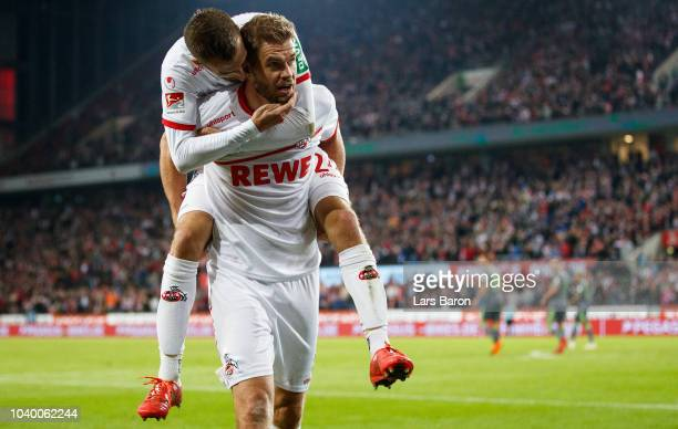 Simon Terodde of Koeln celebrates with team mate Dominick Drexler of Koelnafter scoring his teams second goal during the Second Bundesliga match...