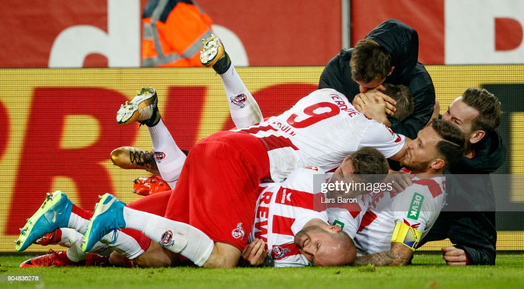 Simon Terodde of Koeln celebrates with team mates after scoring his teams winning goal during the Bundesliga match between 1. FC Koeln and Borussia Moenchengladbach at RheinEnergieStadion on January 14, 2018 in Cologne, Germany.