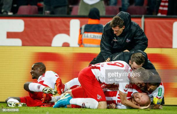 Simon Terodde of Koeln celebrates with team mates after scoring his teams winning goal during the Bundesliga match between 1 FC Koeln and Borussia...