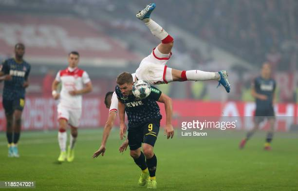 Simon Terodde of Koeln is challenged by Niko Giesselmann of Duesseldorf during the Bundesliga match between Fortuna Duesseldorf and 1. FC Koeln at...