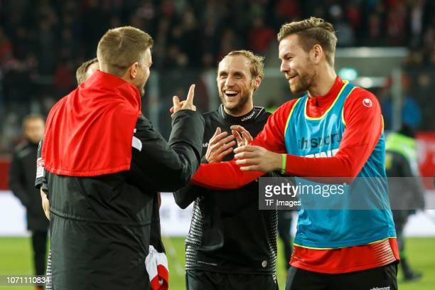 Simon Terodde of Koeln Marcel Risse of Koeln Goalkeeper Thomas Kessler of Koeln celebrates after winning the Second Bundesliga match between SSV Jahn...