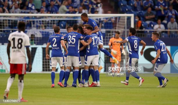 Simon Terodde of Schalke clebrates with team mates after scoring his teams first goal during the Second Bundesliga match between FC Schalke 04 and...