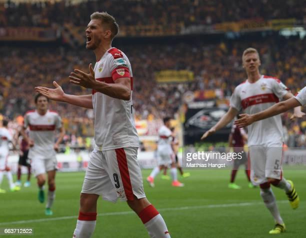 Simon Terodde of Stuttgart celebrates scoring his team's third goal from the penalty spot during the Second Bundesliga match between VfB Stuttgart v...