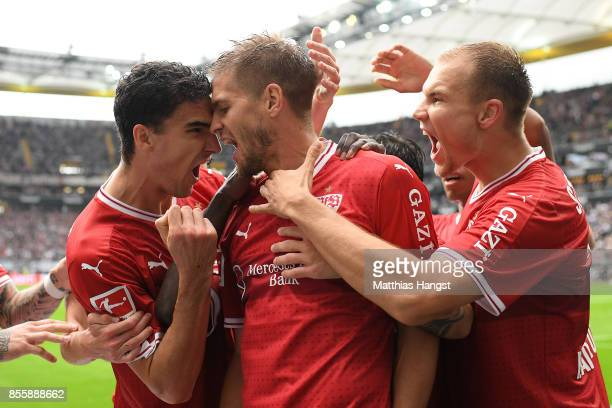 Simon Terodde of Stuttgart celebrates with team mates after he scored his teams first goal to make it 11 during the Bundesliga match between...