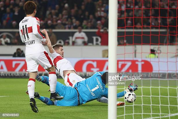 Simon Terodde of Stuttgart scores his team's first goal against goalkeeper Philipp Tschauner of Hannover during the Second Bundesliga match between...