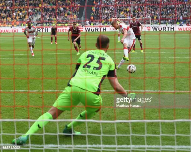 Simon Terodde of Stuttgart shoots past Marvin Schwäbe of Dresden to score his team's third goal from the penalty spot during the Second Bundesliga...