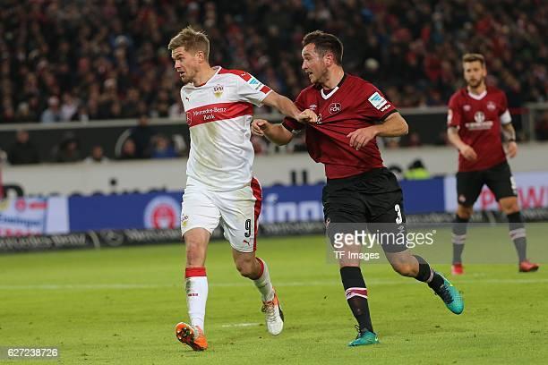 Simon Terodde of Suttgart and Even Hovland of Nuerenberg battle for the ball during the second Bundesliga match between VfB Stuttgart and 1 FC...