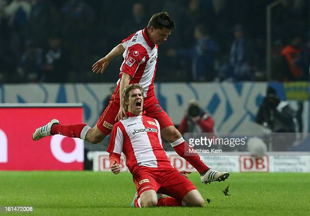 Simon Terodde of Union jubilates with team mate Fabian Schoenheim after scoring the first goal during the Second Bundesliga match between Hertha BSC...