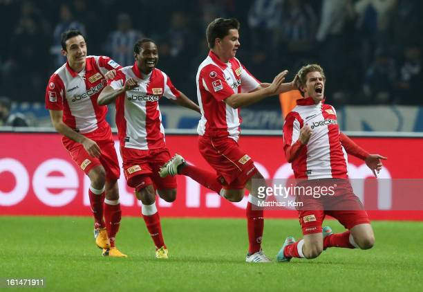 Simon Terodde of Union jubilates with team mates after scoring the first goal during the Second Bundesliga match between Hertha BSC Berlin and 1FC...