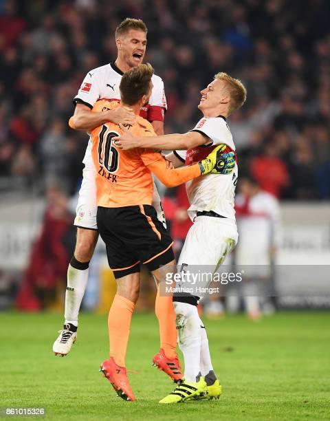 Simon Terodde of VfB Stuttgart RonRobert Zieler of VfB Stuttgart and Timo Baumgartl of VfB Stuttgart celebrate victory in the Bundesliga match...