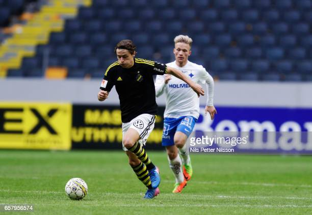 Simon Thern of AIK and Nicklas Barkroth of IFK Norrkoping during the preseason friendly match between AIK and IFK Norrkoping at Friends arena on...